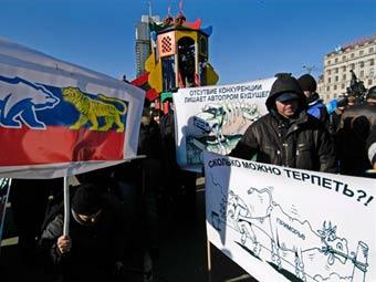 Противники повышения пошлин на иномарки устроили акции в Москве и Петербурге