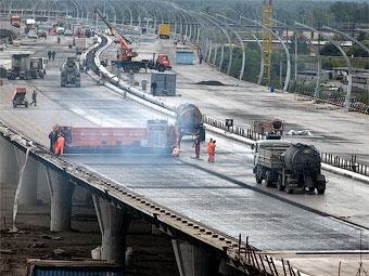 Путин пообещал не урезать финансирование строительства платной дороги в Санкт-Петербурге
