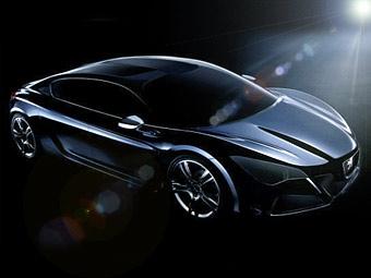 """В Париже Peugeot покажет прототип """"четырехдверного купе"""""""