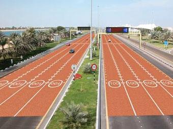 В Абу-Даби в зонах с ограничением скорости уложат красный асфальт