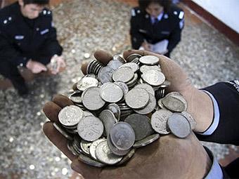 Китаец оплатил покупку машины 700 килограммами монет