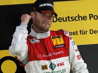 Мартин Томчик выиграл дождевую гонку DTM в Великобритании