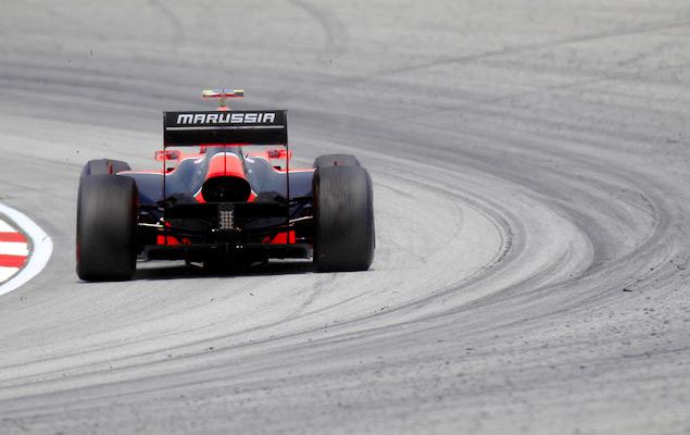 Фернандо Алонсо выиграл дождевой Гран-при Малайзии. Фото 10