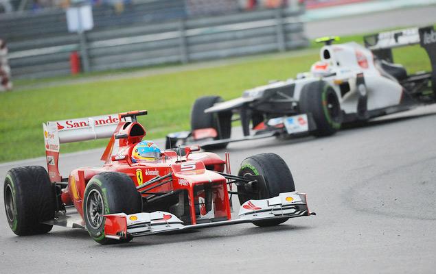 Фернандо Алонсо выиграл дождевой Гран-при Малайзии. Фото 11