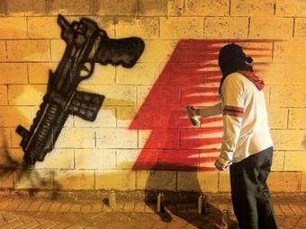 В Бахрейне сожгли флаг с лицом Берни Экклстоуна