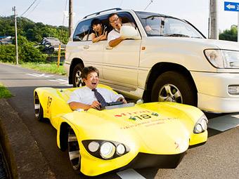 Самой низкой дорожной машиной в мире стал японский электрокар