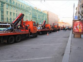 Московские эвакуаторы будут забирать машины из второго и третьего ряда