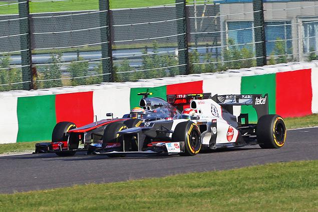 Победа Феттеля вернула интригу в чемпионат Формулы-1. Фото 6