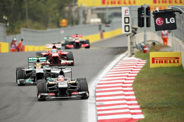 Феттель выиграл четвертую гонку Формулы-1 подряд. Фото 4