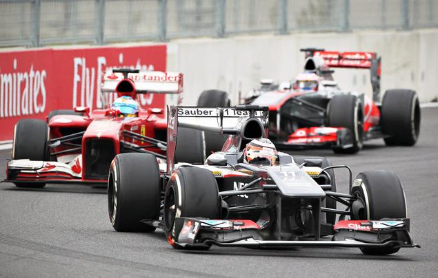 Феттель выиграл четвертую гонку Формулы-1 подряд. Фото 5