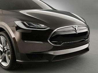 """Новыми электрокарами Tesla займется разработчик """"макбуков"""""""
