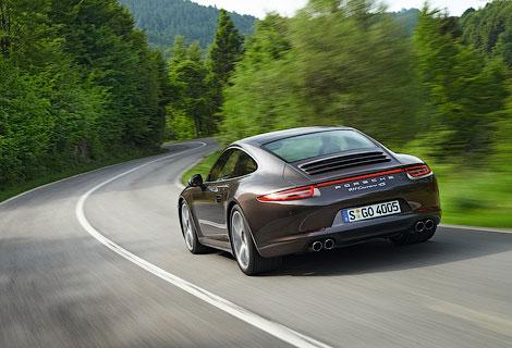 Полноприводный Porsche 911 с увеличенным клиренсом покажут в апреле. Фото 1