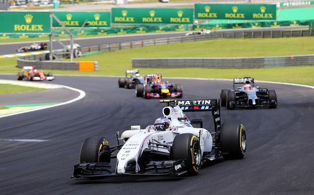 Росберг перед финальной гонкой Формулы-1 сократил отставание от Хэмилтона. Фото 3